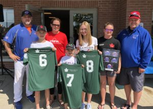 Dan Clewlow Memorial Softball Tournament members holding team jerseys
